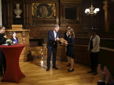 Germany Scholarship recipient receiving the certificate from her sponsor